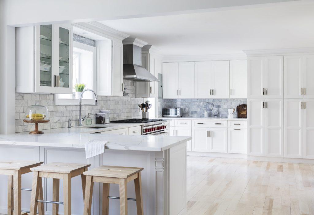 A white fabuwood kitchen cabinet developed by walcraft cabinetry