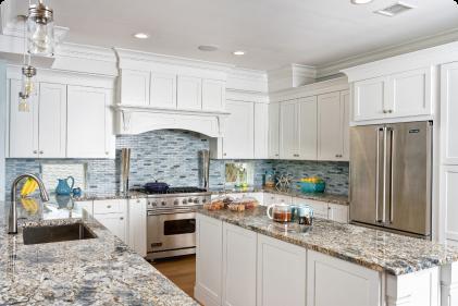 A customer kitchen featuring white kitchen cabinets